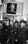 Striking Firemen and their wives march through Oxford in support of their pay claim 1977 - NLA - , Trades Union,1970s,1977,adult,adults,claim,demonstration.,disputes,EARNINGS,EQUALITY,FBU,fire brigade,FIREFIGHTER,Firefighter firefighters,FIREFIGHTERS,FIREMAN,Firemen,Income,INCOMES,INDUSTRIAL DISP