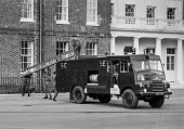 Firemens strike 1977 Soldiers at Woolwich barracks training in firefighting with an old army Green Goddess fire engine in preparation for strike breaking. - NLA - Trades Union,1970s,1977,adult,adults,armed forces,army,disputes,engine,ENGINES,FBU,fire,fire brigade,Fire Engine,FIREFIGHTER,Firefighter firefighters,FIREFIGHTERS,firefighting,FIREMAN,Firemen,fires,Gr