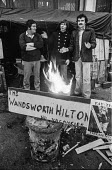 Firemens' strike 1977 picketing Wandsworth fire station just before Christmas, London - NLA - , Trades Union,1970s,1977,Christmas,DISPUTE,DISPUTES,EARNINGS,FBU,fire,Firefighter firefighters,fires,humor humorous,INDUSTRIAL DISPUTE,industrial relations,London,man men,member,member members,member