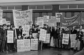 Strike by firemen 1977 Warrington firemen and other local trades union members picket their fire station in support of pay claim - NLA - Trades Union,1970s,1977,adult,adults,banner banners,Cheshire,claim,DISPUTE,DISPUTES,EARNINGS,FBU,fire,fire brigade,FIREFIGHTER,Firefighter firefighters,FIREFIGHTERS,FIREMAN,Firemen,fires,INDUSTRIAL DI
