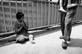 Thailand trafficked from Cambodia young girls are used by begging gangs to beg on the streets of Bangkok. - Nick Rain - 03-06-2004