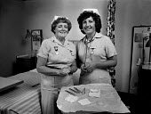 Enrolled Nurse (left) and Nursing Auxiliary, on a ward. - Paul Carter - ,1980s,1983,care,female,HEA health,health,HEALTH SERVICES,healthcare,hospital,HOSPITALS,instrument,instruments,job,jobs,LAB LBR work,medic,medical,medicine,medics,National Health Service,nhs,nurse,nur