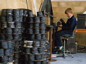 Young man sitting preparing tapes from which electronic dartboards are produced. - Paul Carter - ,1980s,1989,capitalism,capitalist,dartboard,EBF business,electronic,ELECTRONICS,ergonomic,ergonomics,FACTORIES,factory,Industries,industry,job,jobs,LAB LBR work,maker,makers,making,manual,manufacture,