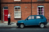 Traffic warden recording the details of an illegally parked car. - Paul Carter - 08-06-1993