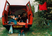 Traveller in his make-shift home, the back of his van, playing the guitar. - Paul Carter - 1990,1990s,accommodation,alternative,country,countryside,freedom,hippies,hippy,home,homeless,homelessness,housing,Leisure,LFL,LIFE,lifestyle,melody,music,MUSICAL,musical instrument,musical instruments