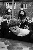 A young miner is forcibly restrained by police as they make arrests during mass picket at Cresswell colliery, Derbyshire. - Peter Arkell - 1980s,1984,adult,adults,arrest,arrested,arresting,CLJ,collieries,colliery,Cresswell,Derbyshire,DISPUTE,DISPUTES,flying picket,handcuffs,INDUSTRIAL DISPUTE,mass,mass picket,MATURE,member,member members