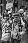 Young and old on a demonstration by miners and their supporters in Barnsley, South Yorkshire. The name on the skull refers to Sir Ian McGregor, chairman of the National Coal Board during the miners st... - Peter Arkell - 15-04-1984