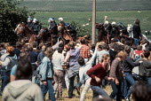 Striking miners confront mounted police at Orgreave coking plant, near Sheffield, South Yorkshire. - Peter Arkell - ,1980s,1984,adult,adults,animal,animals,battle,Battle of Orgreave,BSC Coking Plant,CLJ,coke,coking,confront,confrontation,confronted,confronting,DISPUTE,DISPUTES,domesticated ungulate,domesticated ung