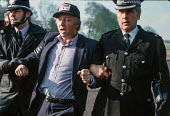 Arthur Scargill is arrested at Orgreave coking plant, South Yorkshire, at a mass picket during the miners strike - Peter Arkell - 1980s,1984,adult,adults,arrest,arrested,arresting,Arthur,Battle of Orgreave,BSC Coking Plant,CLJ,coke,coking,DISPUTE,DISPUTES,force,INDUSTRIAL DISPUTE,mass,MATURE,member,member members,members,MINER,M