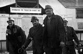 Kent miners at Betteshanger colliery in a confident mood during work to rule just before 1974 strike. The graph behind them shows falling production levels due to the work to rule. - Peter Arkell - 03-02-1974