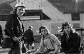 Young Kent miners at Betteshanger colliery in a confident mood during work to rule just before 1974 strike. The graph behind them shows falling production levels due to the work to rule. - Peter Arkell - 03-02-1974