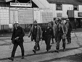 Kent miners at Betteshanger colliery in a confident mood during work to rule just before 1974 strike. The graph behind them shows falling production levels due to the work to rule. - Peter Arkell - 1970s,1974,capitalism,capitalist,change,Coal Industry,Coal Mine,coalfield,coalindustry,collieries,colliery,coming off,disputes,EBF,Economic,Economy,employee,employees,Employment,Graph,Graphs,INDUSTRIA