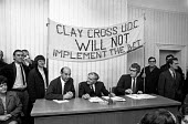 Clay Cross (North Derbyshire) rents dispute. Auditor and his team sent by Heath government to Clay Cross stay seated while a banner is put up behind them by supporters of the council who packed the me... - Peter Arkell - (UDC),1970s,1972,1973,Act,activist,activists,campaign,campaigner,campaigners,campaigning,CAMPAIGNS,Clay Cross,Council,COUNCILER,COUNCILERS,councillor,councillors,councilor,councilors,DEMONSTRATING,dem