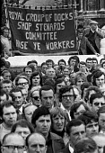 """Docks strike 1972. Mass meeting of all London dockers at Tower Hill, in the days before the arrest of the Pentonville 5. The famous banner of the Royal Group of docks, with the invocation """"Arise Ye Wo... - Peter Arkell - 1970s,1972,anti union law,anti union laws,anti union legislation,Arise Ye Workers,arrest,ARRESTED,ARRESTING,banner banners,disputes,DOCK,Dock strike,Docks,Docks Labour Scheme,docks strike,harbor,harbo"""