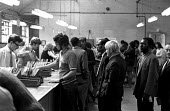 Unemployed people signing on at Brixton Labour Exchange, London. - Peter Arkell - ,1970s,1971,cities,city,employee,employees,Employment,Exchange,interacting,interaction,job,jobless,jobs,jobseeker,jobseekers,lbr,line,male,man,Marginalised,men,on,people,person,persons,precariat,preca