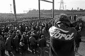 Ford Dagenham mass meeting of all the 50,000 workers at the plant. - Peter Arkell - 1970s,1973,AEU,automotive,Car Industry,carindustry,Dagenham,FACTORIES,factory,Ford,Fords,London,male,man,mass,Mass Meeting,Mass Meetings,meeting,MEETINGS,member,member members,members,men,people,perso