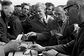 Ford workers at Dagenham voting on the latest offer during the strike. - Peter Arkell - ,1970s,1971,ACTIVIST,ACTIVISTS,automotive,ballot,Ballot Box,BALLOTING,ballots,box,boxes,CAMPAIGN,campaigner,campaigners,CAMPAIGNING,CAMPAIGNS,Car Industry,car workers.,cards,carindustry,Dagenham,democ