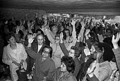 Strike at Trico by 350 women for equal pay. Mass meeting of the women at the Trico-Folberth windscreen wiper factory in West London the day after they walked out when management refused to make up the... - Peter Arkell - 1970s,1976,asian,asians,AUEW,BAME,BAMEs,black,BME,bmes,cultural,disputes,diversity,Equal Pay,Equal Rights,equality,ethnic,ethnicity,FACTORIES,factory,FEMALE,feminism,feminist,feminists,INDUSTRIAL DISP