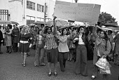 Equal pay strike at Trico, West London. Striking women, members of the AUEW, outside the factory the day after they walked out when management refused to make up the �6 pay differential between men an... - Peter Arkell - 1970s,1976,AUEW,BAME,BAMEs,black,bme,BME black,bmes,cultural,DISPUTE,DISPUTES,diversity,equal pay,equal pay strike,equal rights,equality,ethnic,ethnicity,FACTORIES,factory,FEMALE,feminism,feminist,fem