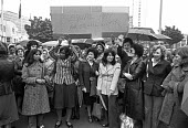 Equal pay strike at Trico, West London. Striking women, members of the AUEW, outside the factory the day after they walked out when management refused to make up the �6 pay differential between men an... - Peter Arkell - 1970s,1976,AUEW,DISPUTE,DISPUTES,EARNINGS,Equal,equal pay,Equal pay strike,equal rights,equality,FACTORIES,factory,FEMALE,feminism,feminist,feminists,INDUSTRIAL DISPUTE,management,member,member member