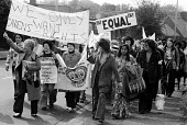 Trico women, on strike for equal pay, marching through West London. Women's Voice newspaper - Peter Arkell - ,1970s,1976,activist,activists,asian,asians,AUEW,BAME,BAMEs,banner,banners,black,BME,bmes,CAMPAIGN,campaigner,campaigners,CAMPAIGNING,CAMPAIGNS,cultural,DEMONSTRATING,demonstration,DEMONSTRATIONS,disp