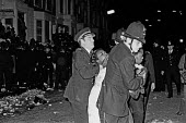 Notting Hill Carnival 1978. Riots - Peter Arkell - ,1970s,1978,adult,adults,arrest,arrested,arresting,BAME,BAMEs,Black,BME,bmes,carnival,Carnivals,cities,City,CLJ,Conflict,Conflicts,diversity,ethnic,ethnicity,FEMALE,force,Hill,male,man,MATURE,men,mino