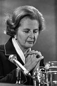 Praying for victory Margaret Thatcher Conservative Party press conference 1979 election. - Peter Arkell - 1970s,1979,campaign,campaigning,CAMPAIGNS,conference,conferences,CONSERVATIVE,Conservative Party,conservatives,DEMOCRACY,ELECTION,elections,FEMALE,General Election,Margaret Thatcher,Party,people,perso