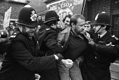 Grunwick strike and lock-out for union recognition of APEX 1977. Mass picket. Police arresting Bill Freeman, NGA activist and leader of the Briant Colour occupation - Peter Arkell - Trades Union,1970s,1977,adult,adults,APEX,arrest,ARRESTED,arresting,at,Bill Freeman,CLJ,de recognition,derecognition,dispute,DISPUTES,Grunwick,INDUSTRIAL DISPUTE,industrial relations,Mass,mass picket,