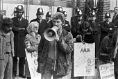 Grunwick strike and lock-out for union recognition of APEX 1977 Mass picket. Des Warren, one of the Shrewsbury 2 building workers jailed for picketing during the building workers strike of 1972, speak... - Peter Arkell - Trades Union,1970s,1977,APEX,at,building,BUILDINGS,CLJ,de recognition,derecognition,Des Warren,dispute,DISPUTES,Grunwick,INDUSTRIAL DISPUTE,industrial relations,Mass,Mass Picket,member,member members,