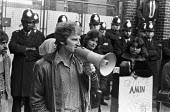 Grunwick strike and lock-out for union recognition of APEX 1977 Mass picket. Des Warren, one of the Shrewsbury Two building workers jailed for picketing during the building workers strike of 1972, spe... - Peter Arkell - , Trades Union,1970s,1977,APEX,Asian Asians,at,BME black,building,BUILDINGS,CLJ,de recognition,derecognition,Des Warren,dispute,DISPUTES,ethnic,ETHNICITY,Grunwick,INDUSTRIAL DISPUTE,industrial relatio