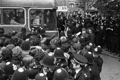 Grunwick strike and lock-out for union recognition of APEX 1977. Strikebreakers bus goes past mass picket with the help of police. - Peter Arkell - , Trades Union,1970s,1977,adult,adults,APEX,at,bus,bus buses,bus service,BUSES,CLJ,de recognition,derecognition,dispute,DISPUTES,Grunwick,INDUSTRIAL DISPUTE,industrial relations,mass,mass picket,MATUR
