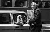 IRA bomb blast at Old Bailey, London. Newspaper seller with news of the bombing - Peter Arkell - ,1970s,1973,adult,adults,AUTO,AUTOMOBILE,AUTOMOBILES,AUTOMOTIVE,Bailey,blast,bomb,bombing,bombings,bombs,buy,buyer,buyers,buying,car,cars,cities,City,commodities,commodity,Conflict,Conflicts,death,dea