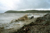 Car left parked at Brean beach , Somerset gets covered by the sea on a spring tide. - Paul Box - 14-07-2000
