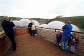 Eco tourism. Visitors take photographs at The Eden Project, St Austell. The Geostatic dome holds plants and vegetation from around the world. It is Cornwalls biggest visitor attraction. - Paul Box - 2000s,2001,a,ACE,Architecture,arts,attraction,Austell,buildings,centre,Cornwall,culture,development,dome,ecotourism,Eden,EDU education,ENI environmental issues,holiday,holiday maker,holiday makers,hol
