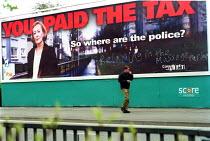 Conservative election campaign poster with graffiti Bristol - Paul Box - 2000s,2001,adult,adults,advert,ADVERTISED,advertisement,advertisements,advertising,ADVERTISMENT,adverts,Anti Capitalist,billboard,BILLBOARDS,campaign,campaigning,CAMPAIGNS,capitalism,capitalist,clj la