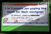 Billboards in Bristol with graffiti. Nationwide mortgages sprayed with graffiti supporting squatting - Paul Box - 2000s,2001,advert,ADVERTISED,advertising,ADVERTISMENT,Anarchism,Anarchist,Anarchists,anarchy,Anti Capitalist,billboard,BILLBOARDS,board,building society,capitalism,capitalist,cities,city,graffiti,home