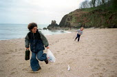 Single mother and son play on Blackpool sands , South Devon - Paul Box - 10-03-2001