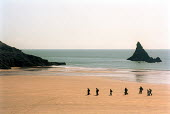 Walkers on Broad Haven beach, South Pembrokeshire. - Paul Box - 24-04-2001