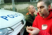 People smoking joints outside Bridewell police station, Bristol. - Paul Box - 02-11-2001