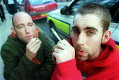 People smoking joints outside Bridewell police station, Bristol - Paul Box - 02-11-2001