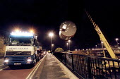 A crane lifting a huge container from a lorry for export, Bristol - Paul Box - 20-11-2001