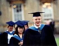 Bath Spa University graduation ceremony - Paul Box - mortarboard,2000s,2001,AFFLUENCE,AFFLUENT,award,Bourgeoisie,ceremonies,ceremony,cloak,EDU education,elite,elitism,EMOTION,EMOTIONAL,EMOTIONS,EQUALITY,gown,gowns,graduate,graduates,graduating,graduatio