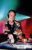 Fat Boy Slim, Norman Cook, plays the dance tent Glastonbury - Paul Box - 2000,2000s,ACE,ace culture entertainment,alcohol,arts,Boy,BOYS,child,CHILDHOOD,children,clubbing,culture,D.J,dance,dancer,dancers,dancing,decks,disc,DJ,Djing,DJs,DRUG,Drugs,EMOTION,EMOTIONAL,EMOTIONS,