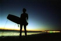 Kite surfer watches the sun set at Weston Super Mare beach - Paul Box - 10-09-2001