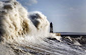 Storm waves smash into the seafront, lighthouse and seawall, Porthcawl, Wales - Paul Box - 07-01-2014