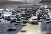 Storm waves leave pebbles on the road at Amroth and break up the road, Wales. - Paul Box - 07-01-2014