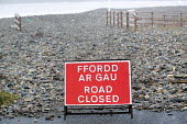 Road closed. Storm waves move a pebble sea defence bank, completely covering the road in Newgale, Pembrokeshire, Wales. - Paul Box - 08-01-2014
