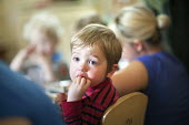 Children eating lunch, Norland Nursery, Bath. - Paul Box - 2010s,2012,boy,boys,BREAK,CARE,carer,carers,child,child care,childcare,CHILD-CARE,CHILDHOOD,childminding,children,CRECH,creche,creches,day care,daycare,DINNER,dinners,DINNERTIME,EARLY,early years,eat,