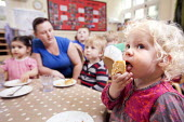 Children eating their lunch, Norland Nursery, Bath. - Paul Box - 2010s,2012,BREAK,CARE,carer,carers,child,child care,childcare,CHILD-CARE,CHILDHOOD,childminding,children,CRECH,creche,creches,day care,daycare,DINNER,dinners,DINNERTIME,EARLY,early years,eat,eating,ed