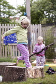 Children playing outside, Norland Nursery, Bath. - Paul Box - 2010s,2012,areas,balance,balancing,CARE,carer,carers,child,child care,childcare,CHILD-CARE,CHILDHOOD,childminding,children,CRECH,creche,creches,day care,daycare,EARLY,early years,edu,educate,educating